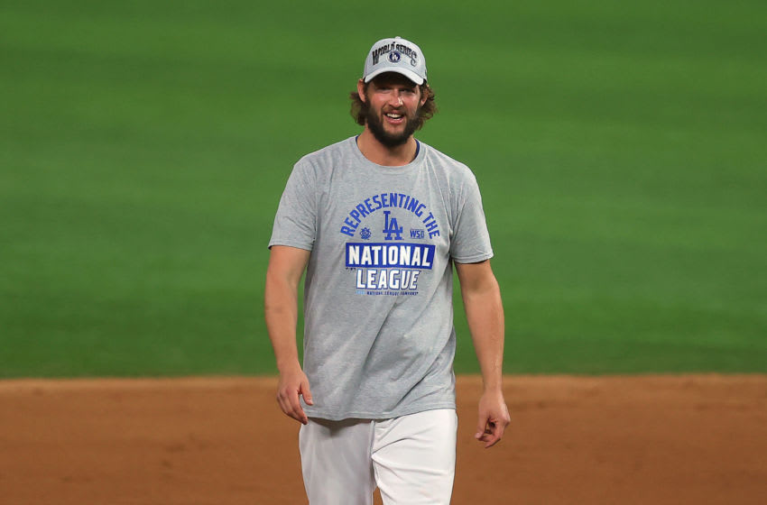 ARLINGTON, TEXAS - OCTOBER 18: Clayton Kershaw #22 of the Los Angeles Dodgers celebrates the teams 4-3 victory against the Atlanta Braves in Game Seven of the National League Championship Series at Globe Life Field on October 18, 2020 in Arlington, Texas. (Photo by Ronald Martinez/Getty Images)