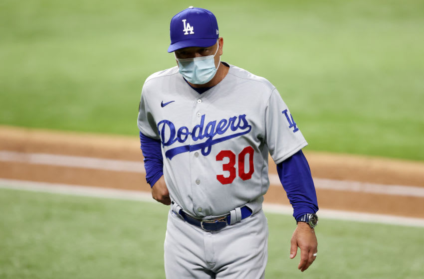 ARLINGTON, TEXAS - OCTOBER 25: Manager Dave Roberts of the Los Angeles Dodgers walks back to the dugout after replacing Clayton Kershaw (not pictured) with Dustin May (not pictured) during the sixth inning against the Tampa Bay Rays in Game Five of the 2020 MLB World Series at Globe Life Field on October 25, 2020 in Arlington, Texas. (Photo by Tom Pennington/Getty Images)