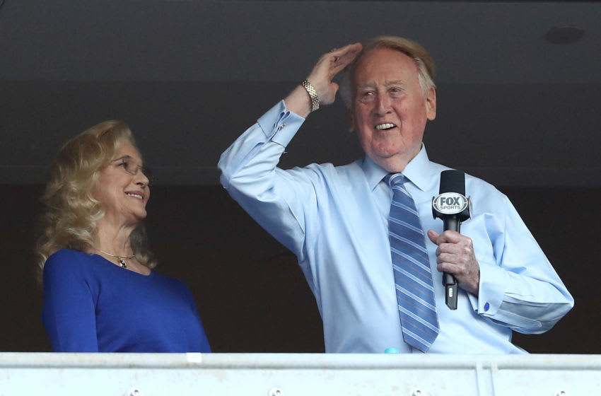 LOS ANGELES, CA - OCTOBER 20: Los Angeles Dodgers broadcaster Vin Scully waves to the crowd alongside his wife Sandra Hunt before the Dodgers take on the Chicago Cubs in game five of the National League Division Series at Dodger Stadium on October 20, 2016 in Los Angeles, California. (Photo by Sean M. Haffey/Getty Images)