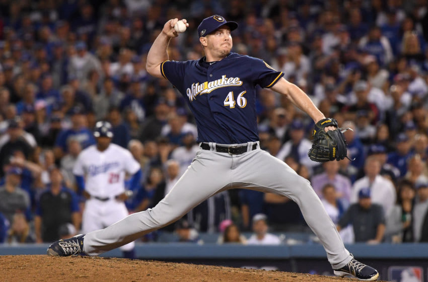 LOS ANGELES, CA - OCTOBER 16: Corey Knebel #46 of the Milwaukee Brewers delivers a pitch in the ninth inning against the Los Angeles Dodgers in Game Four of the National League Championship Series at Dodger Stadium on October 16, 2018 in Los Angeles, California. (Photo by Harry How/Getty Images)