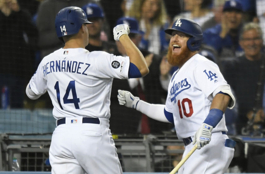 LOS ANGELES, CA - JUNE 18: Justin Turner #10 congratulates Enrique Hernandez #14 of the Los Angeles Dodgers on his grand slam home run against the San Francisco Giants in the seventh inning at Dodger Stadium on June 18, 2019 in Los Angeles, California. (Photo by John McCoy/Getty Images)