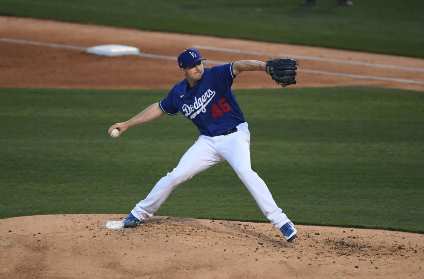 GOODYEAR, ARIZONA - MARCH 03: Corey Knebel #46 of the Los Angeles Dodgers delivers a pitch against the Cincinnati Reds during a spring training game at Camelback Ranch on March 03, 2021 in Goodyear, Arizona. (Photo by Norm Hall/Getty Images)