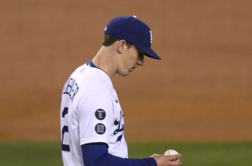 LOS ANGELES, CALIFORNIA - APRIL 22: Walker Buehler #21 of the Los Angeles Dodgers reacts after a solo homerun to Trent Grisham #2 of the San Diego Padres, to trail 2-0, during the sixth inning at Dodger Stadium on April 22, 2021 in Los Angeles, California. (Photo by Harry How/Getty Images)