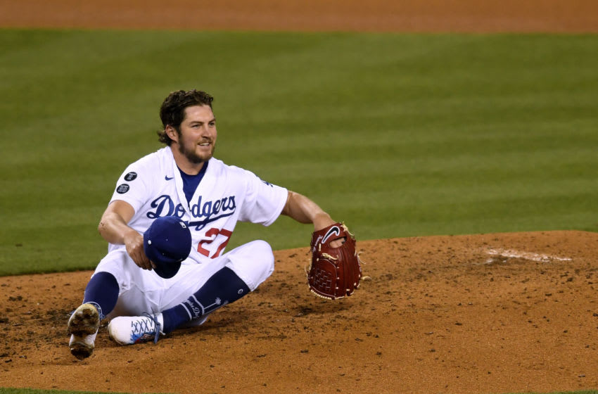 LOS ANGELES, CALIFORNIA - APRIL 24: Trevor Bauer #27 of the Los Angeles Dodgers reacts after a line drive single from Eric Hosmer #30 of the San Diego Padres during the sixth inning at Dodger Stadium on April 24, 2021 in Los Angeles, California. (Photo by Harry How/Getty Images)