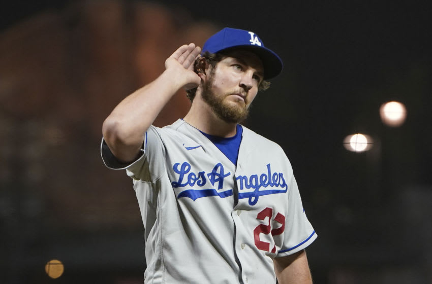 SAN FRANCISCO, CALIFORNIA - MAY 21: Trevor Bauer #27 of the Los Angeles Dodgers reacts to fans booing him as he leaves the game against the San Francisco Giants in the seventh inning at Oracle Park on May 21, 2021 in San Francisco, California. (Photo by Thearon W. Henderson/Getty Images)