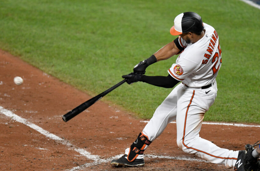 BALTIMORE, MD - SEPTEMBER 01: Anthony Santander #25 of the Baltimore Orioles hits a two-run home run in the sixth inning against the New York Mets at Oriole Park at Camden Yards on September 1, 2020 in Baltimore, Maryland. (Photo by Greg Fiume/Getty Images)