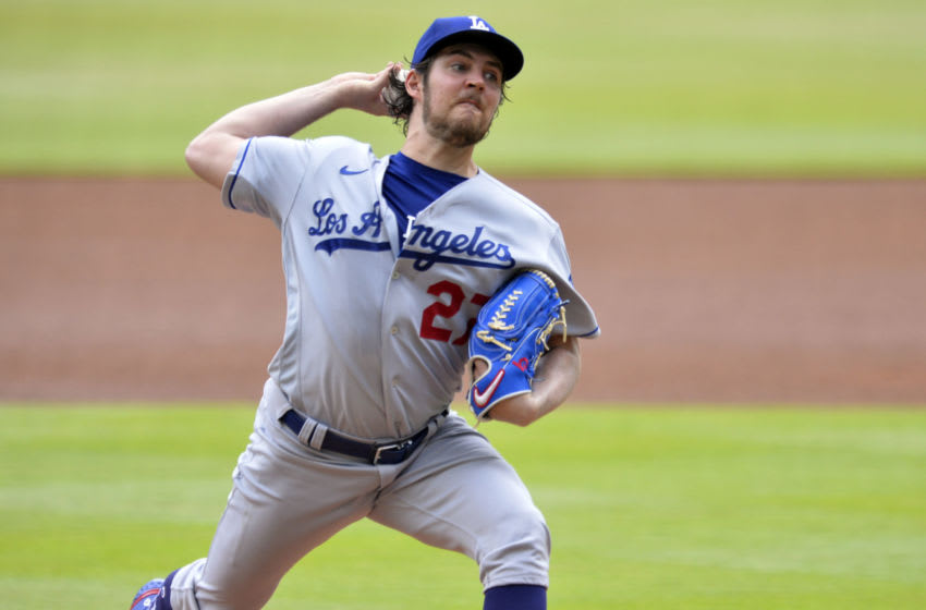 ATLANTA, GA - JUNE 06: Trevor Bauer #27 of the Los Angeles Dodgers pitches against the Atlanta Braves in the first inning at Truist Park on June 6, 2021 in Atlanta, Georgia. (Photo by Edward M. Pio Roda/Getty Images)