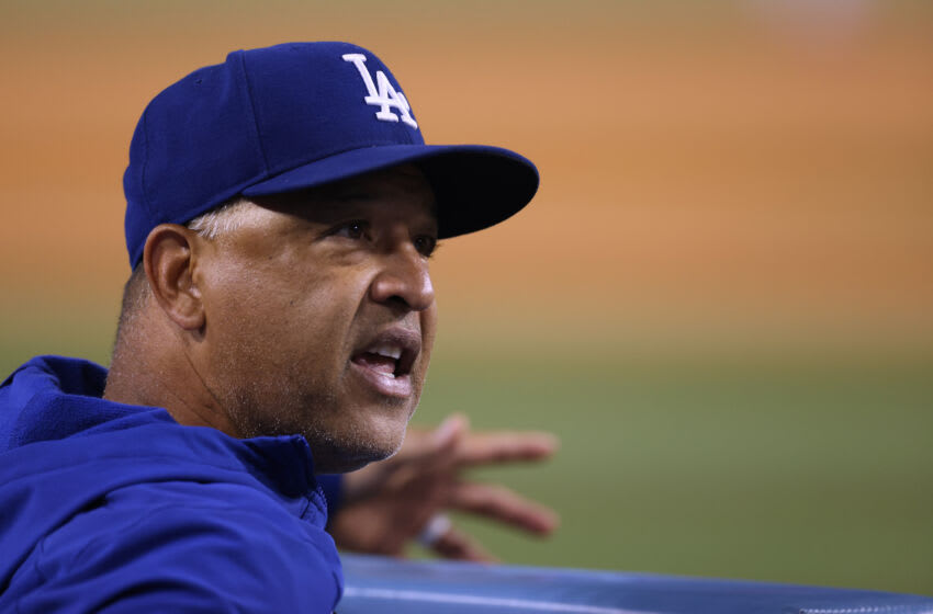 LOS ANGELES, CALIFORNIA - SEPTEMBER 15: Manager Dave Roberts #30 of the Los Angeles Dodgers during the game against the Arizona Diamondbacks at Dodger Stadium on September 15, 2021 in Los Angeles, California. (Photo by Harry How/Getty Images)