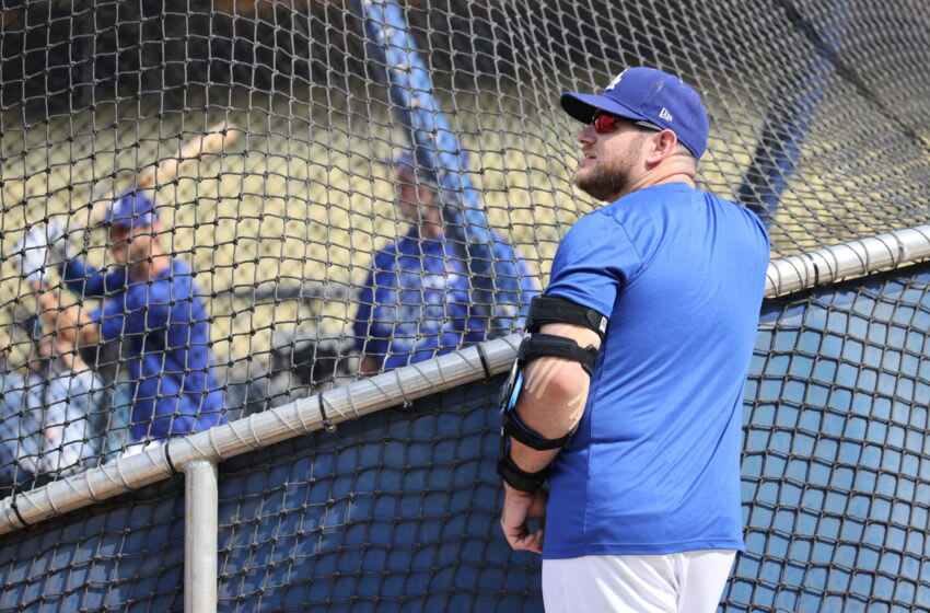 LOS ANGELES, CALIFORNIA - OCTOBER 06: Max Muncy #13 of the Los Angeles Dodgers looks on during batting practice prior to their National League Wild Card Game against the St. Louis Cardinals at Dodger Stadium on October 06, 2021 in Los Angeles, California. (Photo by Harry How/Getty Images)