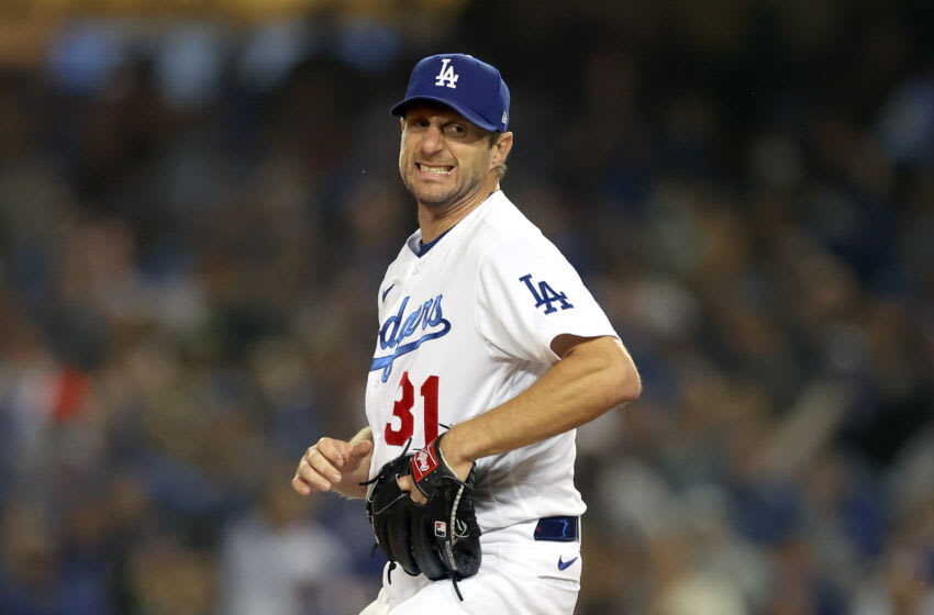 LOS ANGELES, CALIFORNIA - OCTOBER 11: Max Scherzer #31 of the Los Angeles Dodgers reacts after striking out LaMonte Wade Jr. #31 of the San Francisco Giants during the fourth inning in game 3 of the National League Division Series at Dodger Stadium on October 11, 2021 in Los Angeles, California. (Photo by Ronald Martinez/Getty Images)
