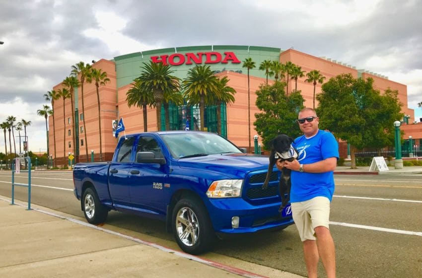 Holland the Pup and Adam Vosding, the Traveling Food Dude, visit the Honda Center. Photo provided by Adam Vosding