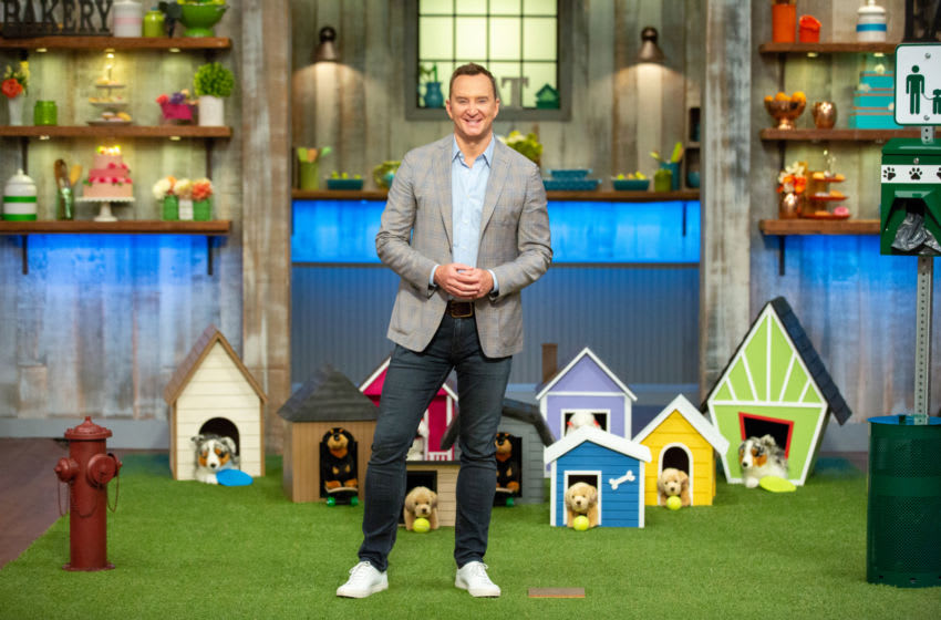 Host Clinton Kelly with dog set details, as seen on Spring Baking Championship, Season 6. photo provided by Food Network