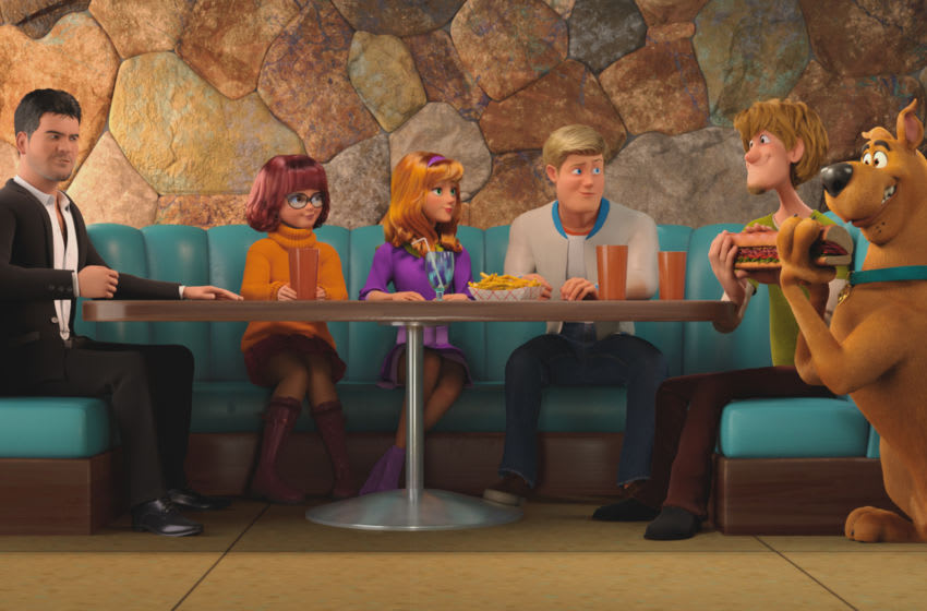 """(L-r) Simon Cowell voiced by SIMON COWELL, Velma voiced by GINA RODRIGUEZ, Daphne voiced by AMANDA SEYFRIED, Fred voiced by ZAC EFRON, Shaggy voiced by WILL FORTE and Scooby-Doo voiced by FRANK WELKER in the new animated adventure """"SCOOB!"""" from Warner Bros. Pictures and Warner Animation Group. Courtesy of Warner Bros. Pictures"""