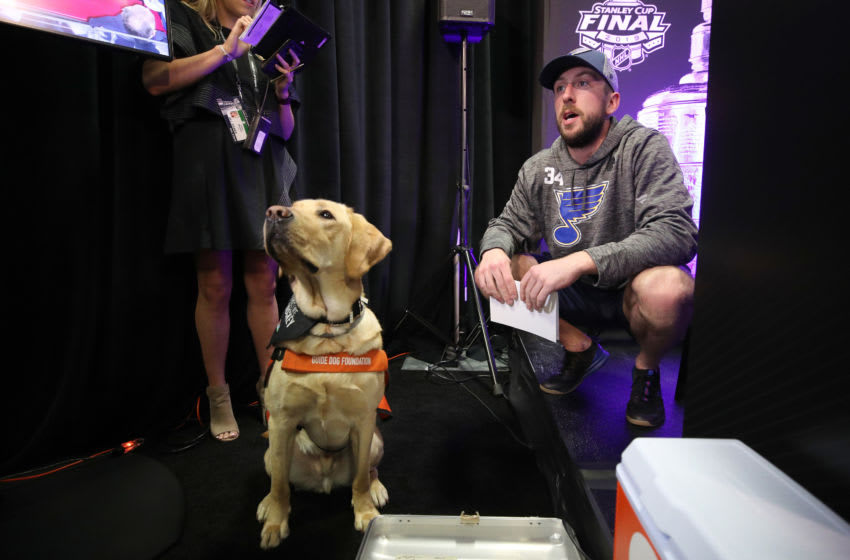 BOSTON, MASSACHUSETTS - MAY 26: Jake Allen #34 of the St. Louis Blues answers questions from a dog during Media Day ahead of the 2019 NHL Stanley Cup Final at TD Garden on May 26, 2019 in Boston, Massachusetts. (Photo by Bruce Bennett/Getty Images)