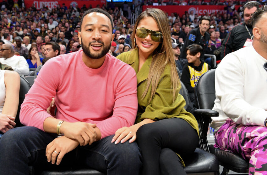 LOS ANGELES, CALIFORNIA - MARCH 08: John Legend and Chrissy Teigen attend a basketball game between the Los Angeles Clippers and the Los Angeles Lakers at Staples Center on March 08, 2020 in Los Angeles, California. (Photo by Allen Berezovsky/Getty Images)