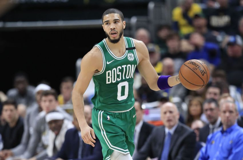 Jayson Tatum #0 of the Boston Celtics dribbles the ball against the Indiana Pacers at Bankers Life Fieldhouse on March 10, 2020 in Indianapolis, Indiana. NOTE TO USER: User expressly acknowledges and agrees that, by downloading and or using this photograph, User is consenting to the terms and conditions of the Getty Images License Agreement. (Photo by Andy Lyons/Getty Images)
