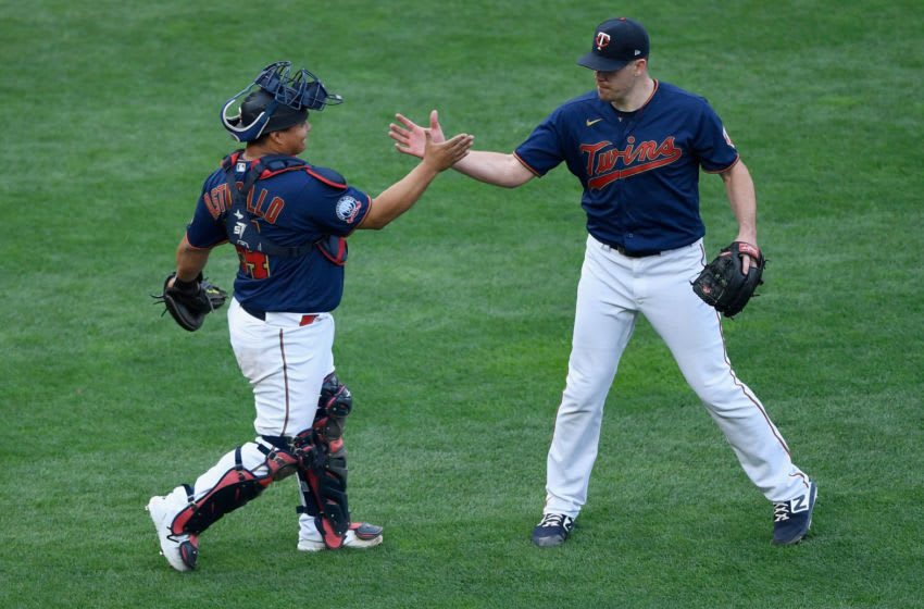 MINNEAPOLIS, MINNESOTA - SEPTEMBER 04: Willians Astudillo #64 and Trevor May #65 of the Minnesota Twins celebrate defeating the Detroit Tigers in game two of a doubleheader at Target Field on September 4, 2020 in Minneapolis, Minnesota. The Twins defeated the Tigers 3-2 in eight innings. (Photo by Hannah Foslien/Getty Images)