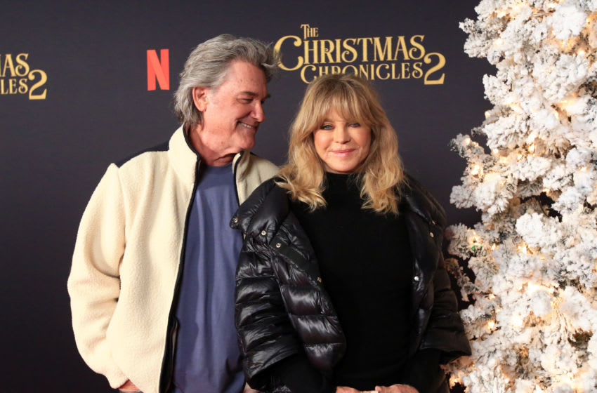 LOS ANGELES, CALIFORNIA - NOVEMBER 19: Kurt Russell (L) and Goldie Hawn attend Netflix's