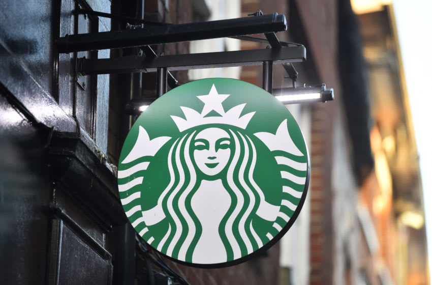 STOKE-ON-TRENT-ENGLAND - NOVEMBER 22: The American Coffeehouse company, Starbucks logo is seen outside one of its stores on November 22, 2020 in Stoke-on-Trent, England . (Photo by Nathan Stirk/Getty Images)