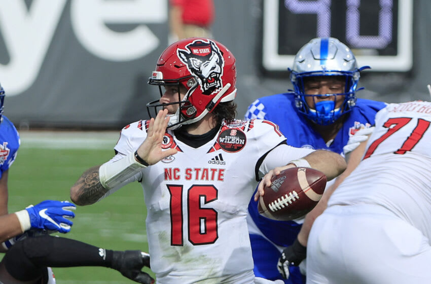 JACKSONVILLE, FLORIDA - JANUARY 02: Bailey Hockman #16 of the North Carolina State Wolfpack attempts a pass against the Kentucky Wildcats during the TaxSlayer Gator Bowl at TIAA Bank Field on January 02, 2021 in Jacksonville, Florida. (Photo by Sam Greenwood/Getty Images)
