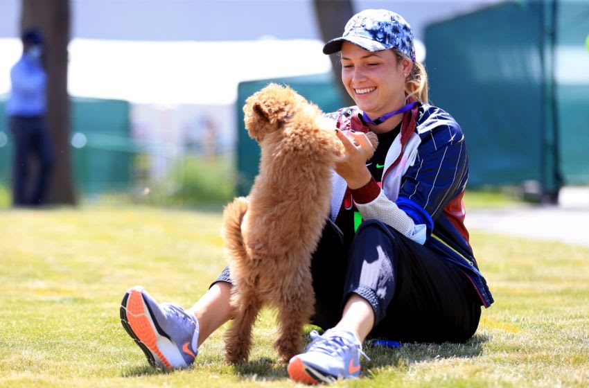 BIRMINGHAM, ENGLAND - JUNE 15: Donna Vekic of Croatia relaxes with her dog while spectating during the Viking Classic Birmingham at Edgbaston Priory Club on June 15, 2021 in Birmingham, England. (Photo by Stephen Pond/Getty Images for LTA)