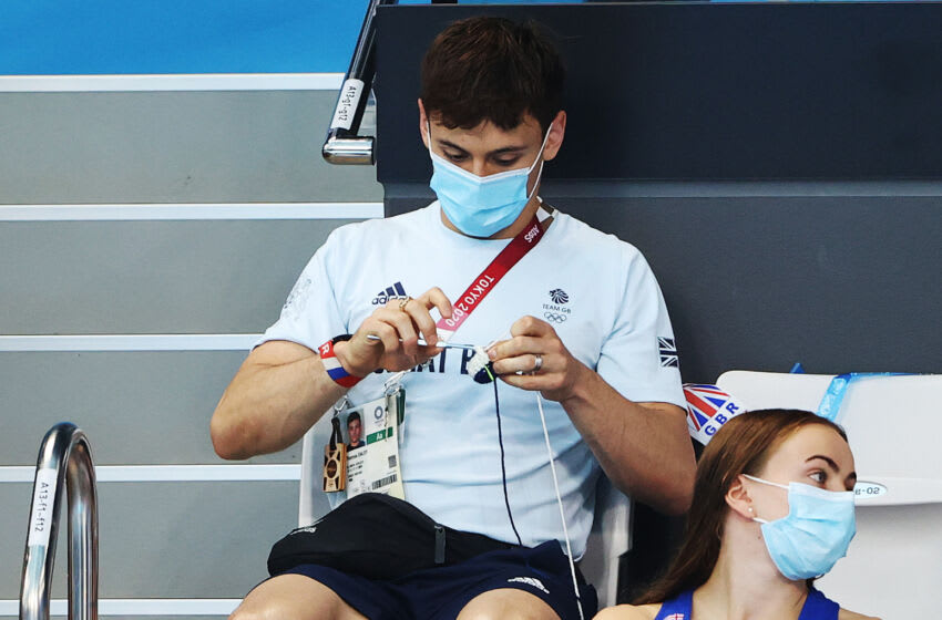 TOKYO, JAPAN - AUGUST 03: Tom Daley of Great Britain is seen in the stands during the Men's 3m Springboard final on day eleven of the Tokyo 2020 Olympic Games at Tokyo Aquatics Centre on August 03, 2021 in Tokyo, Japan. (Photo by Ian MacNicol/Getty Images)