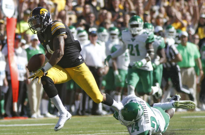 IOWA CITY, IA - SEPTEMBER 26: Wide receiver Tevaun Smith #4 of the Iowa Hawkeyes makes a reception in the first half against defensive back Zac Whitfield #24 of the North Texas Mean Green on September 26, 2015 at Kinnick Stadium, in Iowa City, Iowa. (Photo by Matthew Holst/Getty Images)