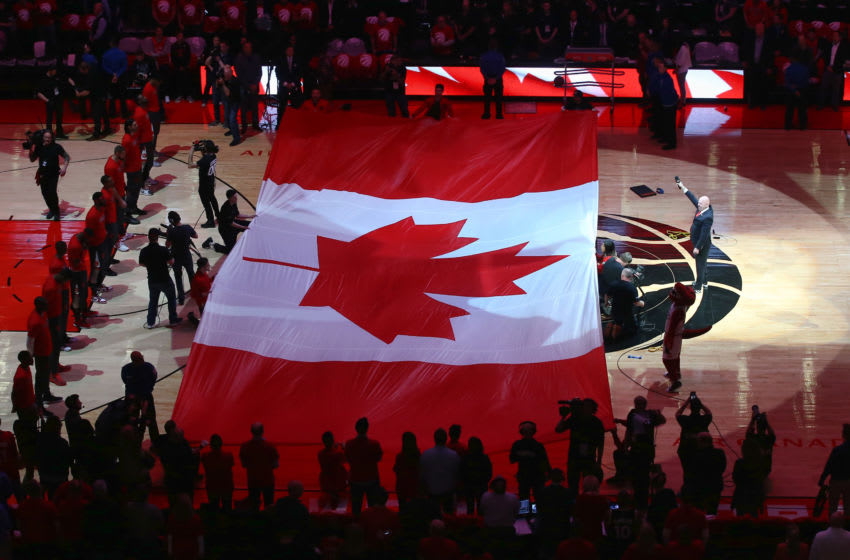 TORONTO, CANADA - APRIL 16: A large Canadian flag is unfurled during the singing of O Canada before the start of the Toronto Raptors game against the Indiana Pacers in Game One of the Eastern Conference Quarterfinals during the 2016 NBA Playoffs on April 16, 2016 at the Air Canada Centre in Toronto, Ontario, Canada. NOTE TO USER: User expressly acknowledges and agrees that, by downloading and or using this photograph, User is consenting to the terms and conditions of the Getty Images License Agreement. (Photo by Tom Szczerbowski/Getty Images)