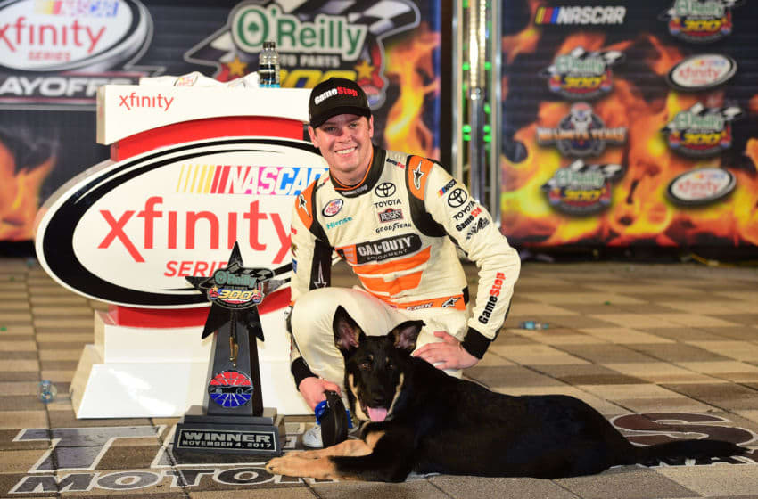 FORT WORTH, TX - NOVEMBER 04: Erik Jones, driver of the #20 GameStop/Call of Duty WWII Toyota, poses with his dog, Oscar, in Victory Lane after winning the NASCAR XFINITY Series O'Reilly Auto Parts 300 at Texas Motor Speedway on November 4, 2017 in Fort Worth, Texas. (Photo by Jared C. Tilton/Getty Images for Texas Motor Speedway)