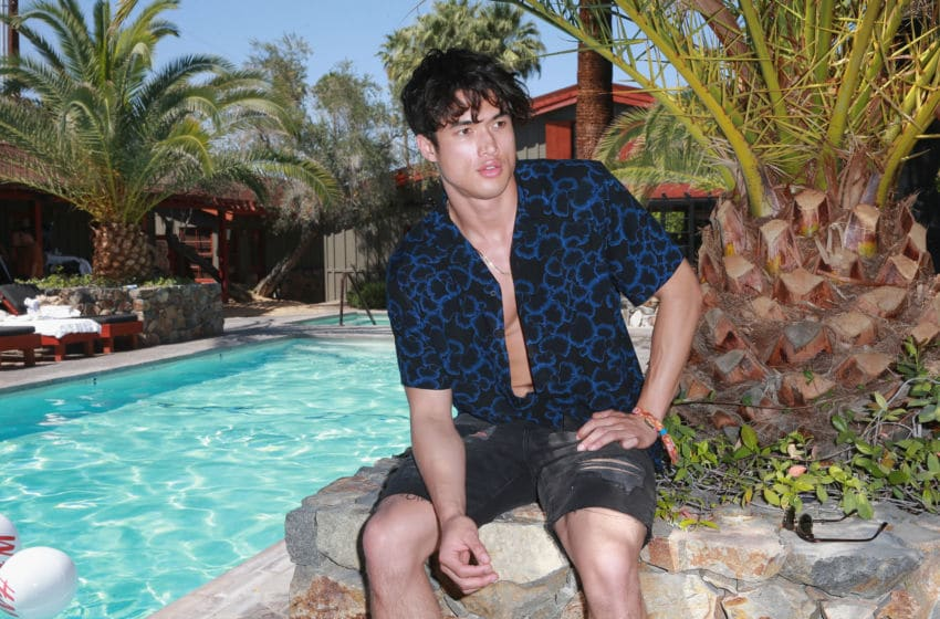 PALM SPRINGS, CA - APRIL 14: Charles Melton poolside with H&M at The Sparrows Lodge on April 14, 2018 in Palm Springs, California. (Photo by Rich Fury/Getty Images for H&M)