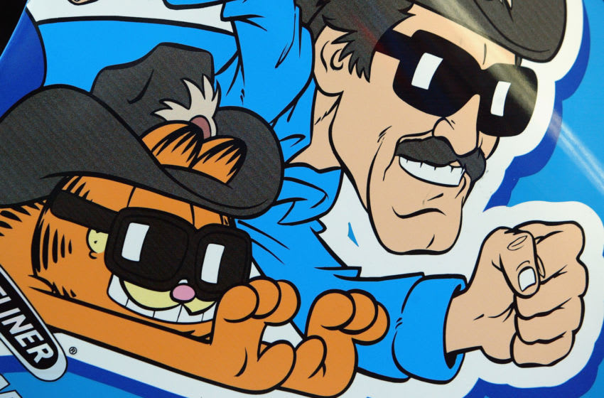 INDIANAPOLIS - AUGUST 1: A cartoon of Richard Petty and Garfield adorns the car of Kyle Petty, driver of the #45 Petty Enterprises Dodge Intrepid during practice for the NASCAR Brickyard 400 on August 1, 2003 at the Indianapolis Motor Speedway in Indianapolis, Indiana. (Photo by Jamie Squire/Getty Images)
