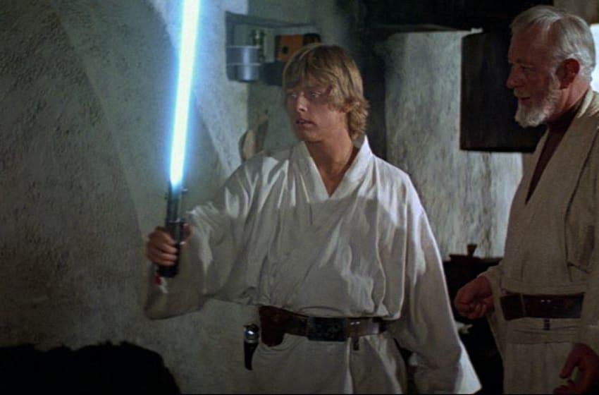 STAR WARS: EPISODE IV - A NEW HOPE Luke Skywalker (Mark Hamill) and Obi-Wan Kenobi/Ben Kenobi ( Alec Guinness). COURTESY OF DISNEY MEDIA DISTRIBUTION