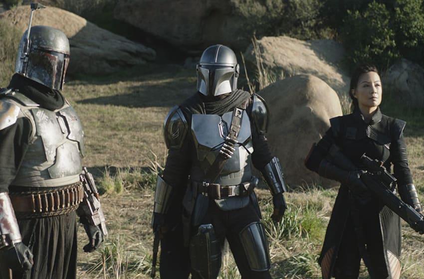 Pedro Pascal is The Mandalorian, Temuera Morrison is Boba Fett and Ming-Na Wen is Fennec in The Mandalorian season 2. Photo: Disney+.