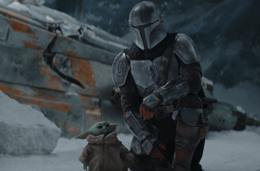 The Mandalorian (Pedro Pascal) and the Child in THE MANDALORIAN, season two, exclusively on Disney+. Image courtesy Disney+
