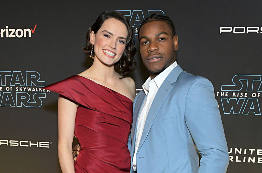 HOLLYWOOD, CALIFORNIA - DECEMBER 16: (L-R) Daisy Ridley and John Boyega arrive for the World Premiere of