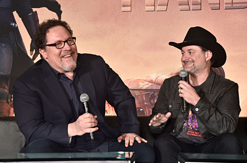 WEST HOLLYWOOD, CALIFORNIA - OCTOBER 19: Executive producers/writers Jon Favreau (L) and Dave Filoni of Lucasfilm's