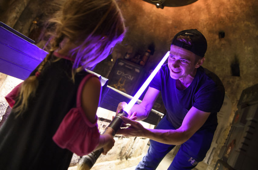 ANAHEIM, CA - OCTOBER 29: In this handout photo provided by Disneyland Resort, actor Hayden Christensen shares a moment with his daughter, on her birthday, after building a custom lightsaber in Savis Workshop at Star Wars: Galaxys Edge at Disneyland Park on October 29, 2019 in Anaheim, California. (Photo by Richard Harbaugh/Disneyland Resort via Getty Images)