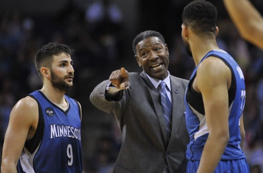 Feb 19, 2016; Memphis, TN, USA; Minnesota Timberwolves head coach Sam Mitchell talks with guard Ricky Rubio (9) and guard Zach LaVine (8) during the second half against the Memphis Grizzlies at FedExForum. Memphis Grizzlies defeated the Minnesota Timberwolves 109-104. Mandatory Credit: Justin Ford-USA TODAY Sports
