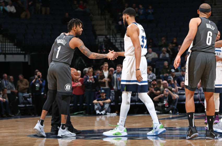 MINNEAPOLIS, MN - NOVEMBER 12: D'Angelo Russell #1 of the Brooklyn Nets and Karl-Anthony Towns #32 of the Minnesota Timberwolves. Copyright 2018 NBAE (Photo by David Sherman/NBAE via Getty Images)