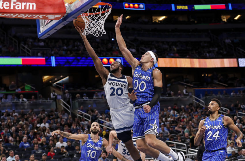 ORLANDO, FL - FEBRUARY 7: Josh Okogie #20 of the Minnesota Timberwolves goes up for a lay-up over Aaron Gordon #00 of the Orlando Magic. (Photo by Don Juan Moore/Getty Images)