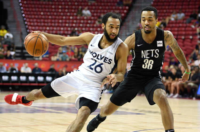 LAS VEGAS, NEVADA - JULY 14: Jordan McLaughlin #26 of the Minnesota Timberwolves drives against Jon Davis #36 of the Brooklyn Nets during a semifinal game of the 2019 NBA Summer League at the Thomas & Mack Center on July 14, 2019 in Las Vegas, Nevada. The Timberwolves defeated the Nets 85-77. NOTE TO USER: User expressly acknowledges and agrees that, by downloading and or using this photograph, User is consenting to the terms and conditions of the Getty Images License Agreement. (Photo by Ethan Miller/Getty Images)