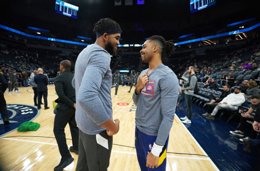MINNEAPOLIS, MN - NOVEMBER 8: Karl-Anthony Towns #32 of the Minnesota Timberwolves greets D'Angelo Russell #0 of the Golden State Warriors during pregame warmups on November 8, 2019 at Target Center in Minneapolis, Minnesota. NOTE TO USER: User expressly acknowledges and agrees that, by downloading and or using this Photograph, user is consenting to the terms and conditions of the Getty Images License Agreement. Mandatory Copyright Notice: Copyright 2019 NBAE (Photo by Jordan Johnson/NBAE via Getty Images)