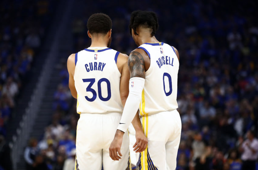 SAN FRANCISCO, CALIFORNIA - OCTOBER 24: Stephen Curry #30 of the Golden State Warriors talks to D'Angelo Russell #0 during their game against the LA Clippers at Chase Center on October 24, 2019 in San Francisco, California. NOTE TO USER: User expressly acknowledges and agrees that, by downloading and or using this photograph, User is consenting to the terms and conditions of the Getty Images License Agreement. (Photo by Ezra Shaw/Getty Images)