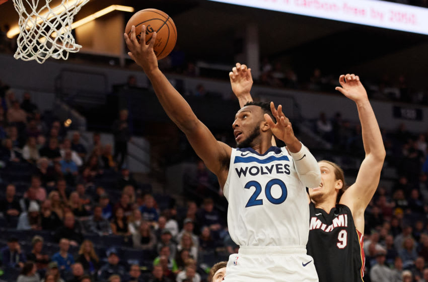 MINNEAPOLIS, MINNESOTA - OCTOBER 27: Josh Okogie #20 of the Minnesota Timberwolves shoots the ball against Kelly Olynyk #9 of the Miami Heat. (Photo by Hannah Foslien/Getty Images)