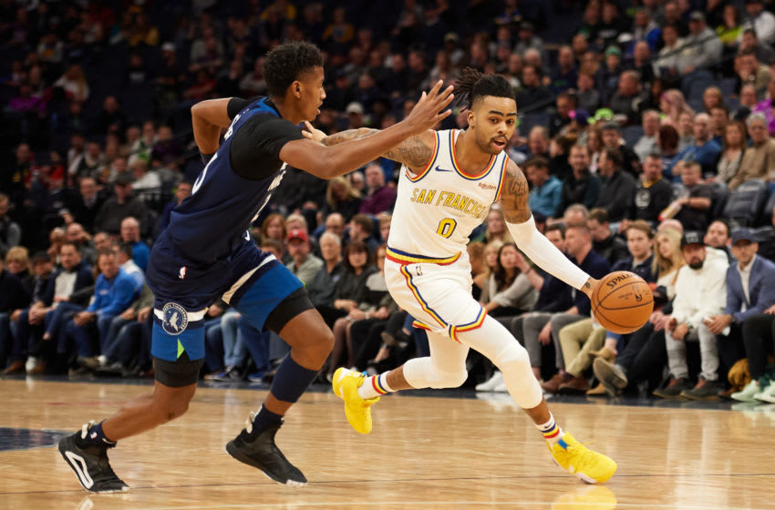 MINNEAPOLIS, MINNESOTA - NOVEMBER 08: D'Angelo Russell #0 of the Golden State Warriors drives to the basket against Jarrett Culver #23 of the Minnesota Timberwolves. (Photo by Hannah Foslien/Getty Images)