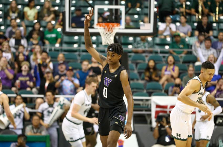 HONOLULU, HI - DECEMBER 23: Jaden McDaniels #0 of the Washington Huskies holds up three fingers after draining a three pointer during the second half of the game against the Hawaii Rainbow Warriors at the Stan Sheriff Center on December 23, 2019 in Honolulu, Hawaii. (Photo by Darryl Oumi/Getty Images)