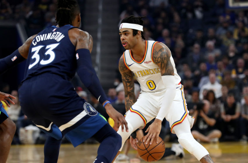 SAN FRANCISCO, CA: DECEMBER 23: Golden State Warriors' D'Angelo Russell #0 dribbles between his legs as he's guarded by Minnesota Timberwolves' Robert Covington #33 in the first quarter of their NBA game at the Chase Center in San Francisco, Calif., on Monday, Dec. 23, 2019. (Jane Tyska/Digital First Media/The East Bay Times via Getty Images)