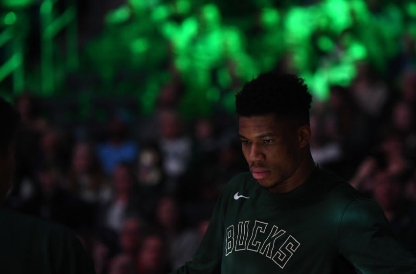MILWAUKEE, WISCONSIN - JANUARY 01: Giannis Antetokounmpo #34 of the Milwaukee Bucks walks onto the court for player introductions prior to a game against the Minnesota Timberwolves at Fiserv Forum on January 01, 2020 in Milwaukee, Wisconsin. NOTE TO USER: User expressly acknowledges and agrees that, by downloading and or using this photograph, User is consenting to the terms and conditions of the Getty Images License Agreement. (Photo by Stacy Revere/Getty Images)
