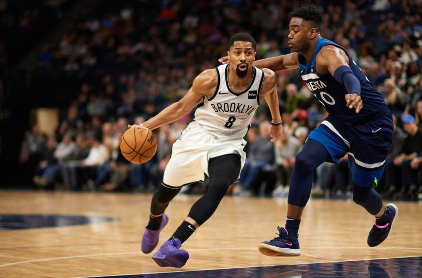 MINNEAPOLIS, MINNESOTA - DECEMBER 30: Spencer Dinwiddie #8 of the Brooklyn Nets drives to the basket against Kelan Martin #30 of the Minnesota Timberwolves. (Photo by Hannah Foslien/Getty Images)