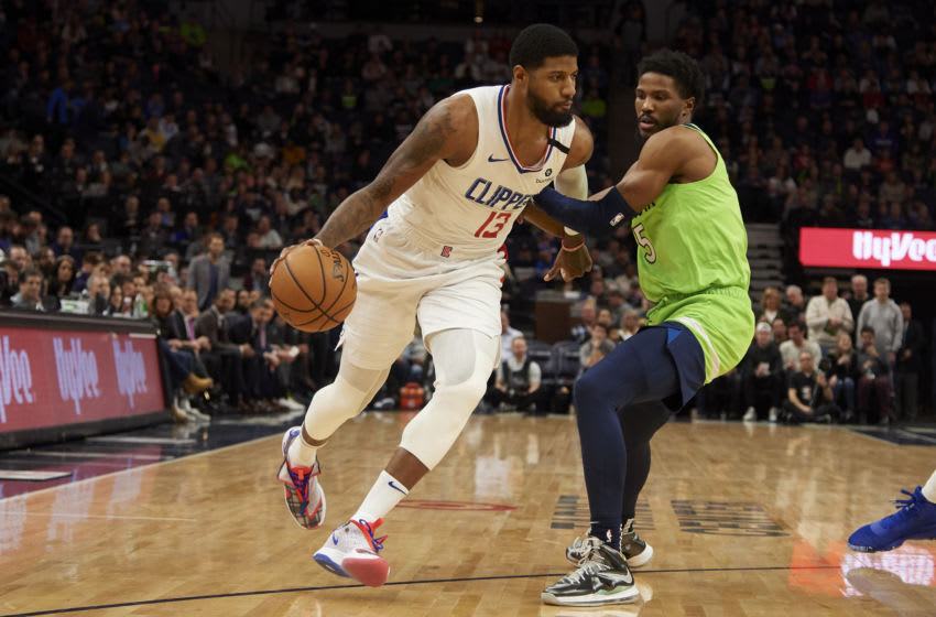 Paul George of the Los Angeles Clippers drives to the basket against Malik Beasley of the Minnesota Timberwolves. (Photo by Hannah Foslien/Getty Images)